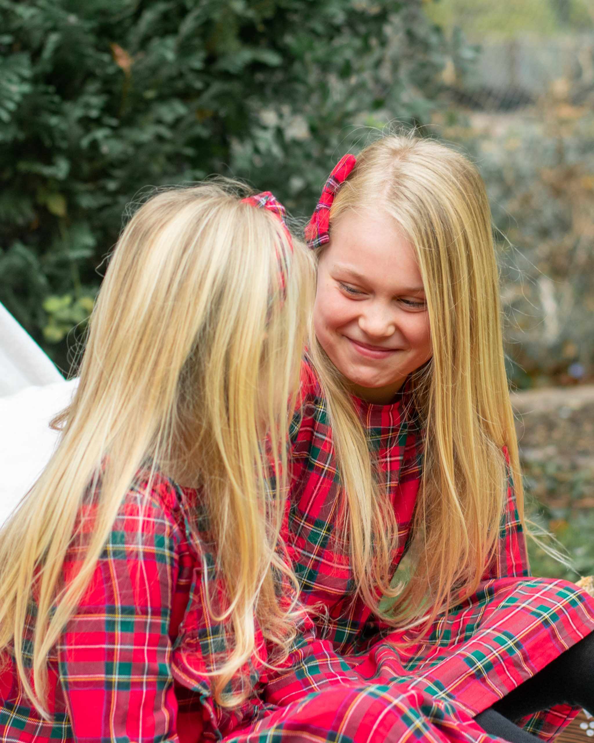 sisters laughing with each other