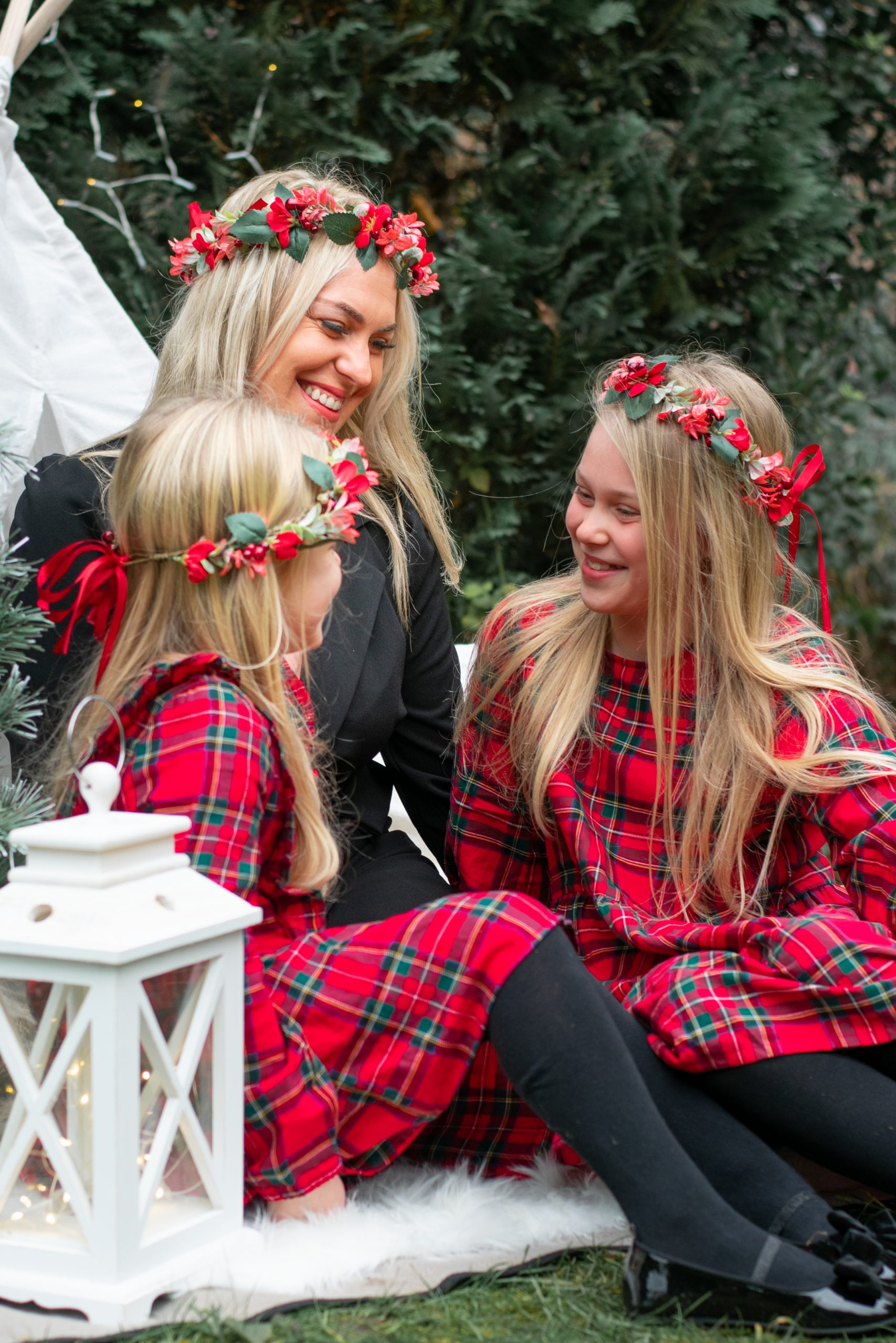 mum and daughters laughing together
