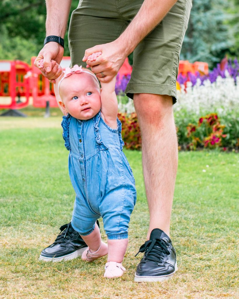 father helping his baby to walk